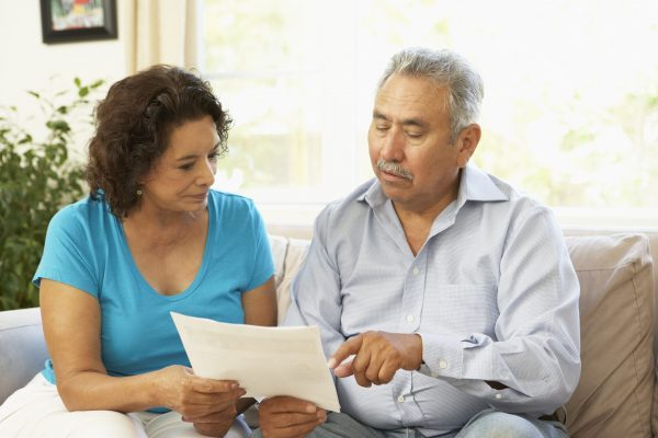 latino couple reviewing AD document